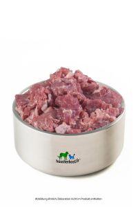 Putenfleischstücke mit Haut